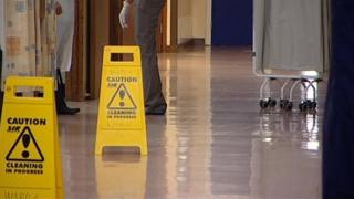 A hospital with cleaning signs