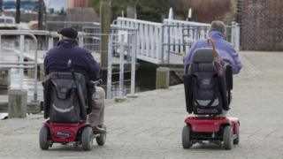 Men on mobility scooters in Lymington, Hampshire