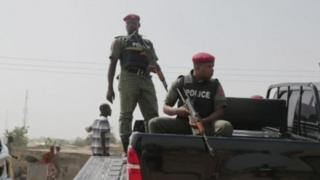 Nigerian police at the scene of the mosque attack in north-east Nigeria, 1 May 2018