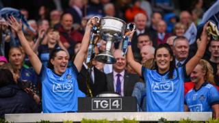 Sinéad Goldrick, left, and Hannah O'Neill of Dublin lift the Brendan Martin Cup following the TG4 All-Ireland Ladies Football Senior Championship Final match between Dublin and Galway at Croke Park in Dublin. (Photo By Stephen McCarthy/Sportsfile via Getty Images)