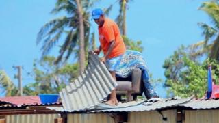 A resident repairing his damaged house following Cyclone Winston in Fiji's Ba district (22 February 2016)