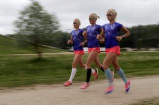 Marathon runners Lily, Liina and Leila Luikare
