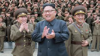 Kim Jong-un clapping as he inspected the Korean People's Army in 2017, with an audience of soldiers in the background