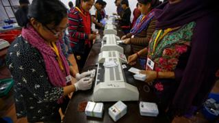 Officials prepare voters identity cards at election commission in Kathmandu