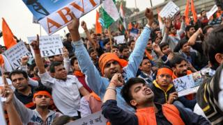 Indian demonstrators shout slogans during a rally against the Jawaharlal Nehru University Students Union (JNUSU) in New Delhi on February 12, 2016