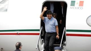 Evo Morales waves during his arrival to take asylum in Mexico, in Mexico City, Mexico, November 12, 2019