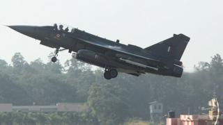 A HAL Tejas multirole light combat aircraft takes off