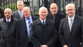 Photograph of the so-called 'hooded men' outside court'