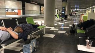 People sleeping in an airport
