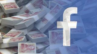 Fejsbuk logo preko novca