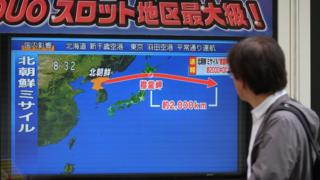 A man watches news about North Korean missile launch on Japanese TV