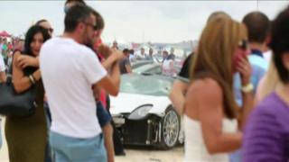 The Porsche supercar span out of control at high speed, hitting spectators