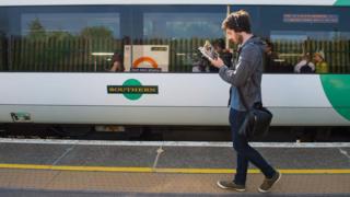 A rail passenger and a train