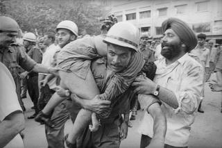 Firemen rescue people during the fire at Uphaar Cinema in 1997