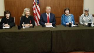 Republican presidential candidate Donald Trump, center, sits with, from right, Paula Jones, Kathy Shelton, Juanita Broaddrick, and Kathleen Willey in St. Louis, Missouri.