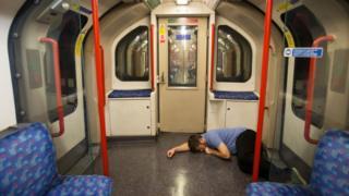 Man sleeping on Night Tube