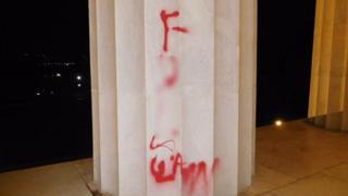 The red graffiti on a pillar