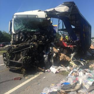 One of the crashed lorries