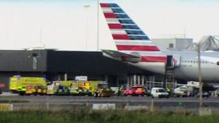 Emergency vehicles near an American Airlines plane at Dublin airport