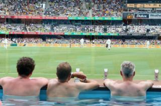fans enjoy the pool deck on Day One of the First Test match between Australia and England at the Gabba in Brisbane
