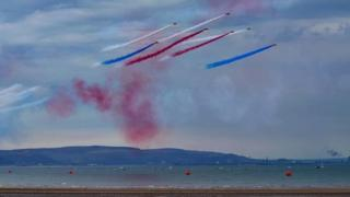 The Red Arrows over a Swansea beach