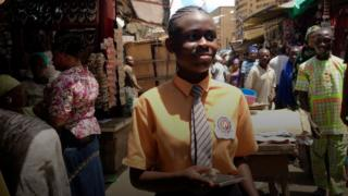 Tomisin in a market in Ikeja