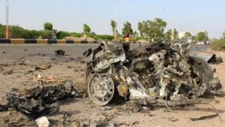 The destruction following a car bomb attack that targeted a convey of three senior south Yemeni officials in the Inma district, north of the the southern Yemeni city of Aden