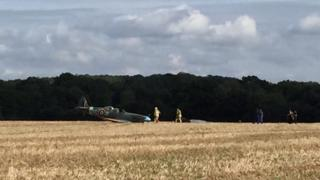 Emergency services with the downed Spitfire in Woodchurch, Kent
