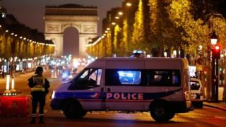 Police secure the Champs-Elysees in Paris