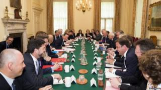 David Cameron chairing a cabinet meeting in May