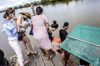 Cambodian students set out on a trip to see the mangroves