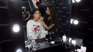 A makeup artist works on a model during the Tunis Fashion Week 2018 in Tunis, Tunisia, 12 May 2018