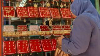 A woman looking in a jewellery shop window in Egypt