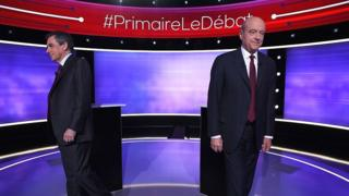 The two finalists in France's conservative presidential primary, Francois Fillon (L) and Alain Juppe, prior to taking part in the first televised debate between the two remaining candidates for the right-wing Republicans party primaries in Paris on 24 November 2016