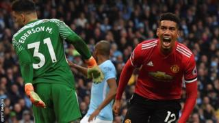 Chris Smalling celebrates scoring Manchester United's winner