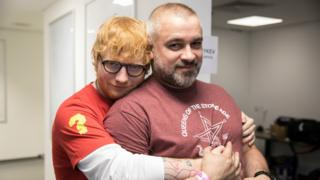 Ed Sheeran hugs Stuart Camp