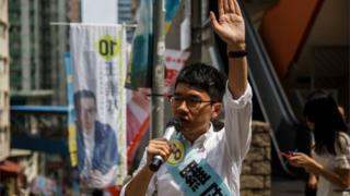 Nathan Law, 23, a leader of the 2014 pro-democracy rallies, campaigns for his political party Demosisto party during the Legislative Council election in Hong Kong on September 4, 2016.