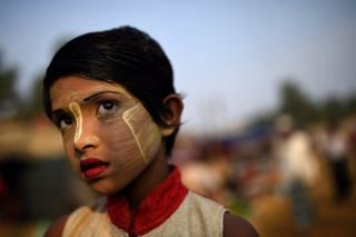 Rohingya refugee girl named Rufia Begum, aged 9, poses for a photograph as she wears thanaka paste at Balukhali camp in Cox's Bazaar, Bangladesh