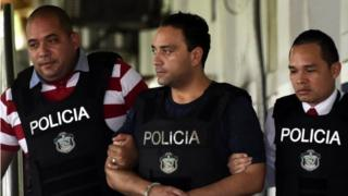 This file picture taken on June 5, 2017 shows the former governor of the Mexican state of Quintana Roo, Roberto Borge (C), the sixth Mexican ex-governor under arrest for corruption, fraud, money laundering or involvement in organized crime, as he is being escorted by Panamanian police in Panama City.