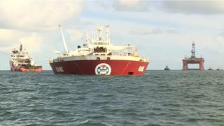 Hawk Transport ship with Transocean rig in background