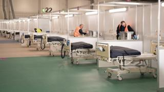 Contractors work at ExCel London, which was converted into the temporary NHS Nightingale Hospital