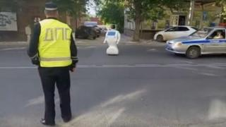 Robot standing in traffic
