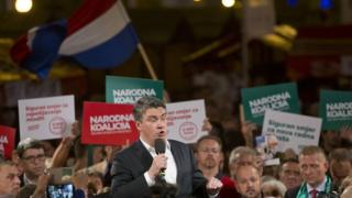 Centre-left leader Zoran Milanovic talks to supporters at a rally in Zagreb on 7 Sept
