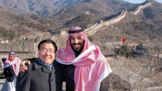 Saudi Arabia's Crown Prince Mohammed bin Salman poses for camera with the Chinese Ambassador to Saudi Arabia Li Huaxin during a visit to Great Wall of China in Beijing