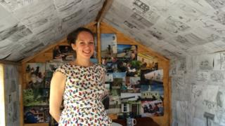 Elizabeth in one of the sheds decorated with the sketches