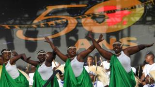 """Rwanda""""s artists perform on stage during the opening ceremony of the FESPACO Panafrican Film and Television Festival of Ouagadougou, in Burkina Faso, on February 23, 2019."""