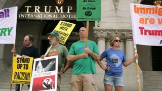 Protestors gather outside Donald Trump's Washington, DC, hotel.