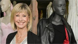 Olivia Newton-John next to her jacket before the auction