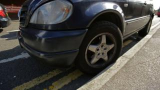 Car on double yellow lines