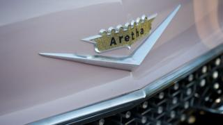 A Cadillac with Aretha's name emblazoned on the front